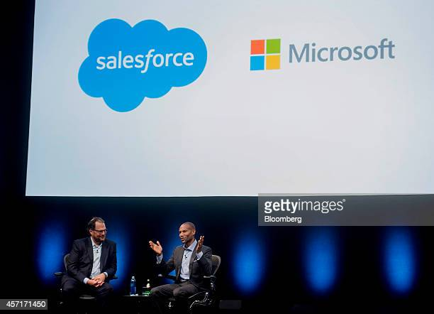 Marc Benioff, chairman and chief executive officer of Salesforce.com Inc., left, speaks with Tony Prophet, vice president of Windows marketing at...