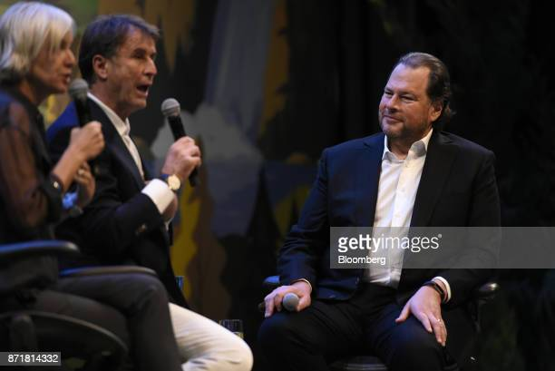 Marc Benioff chairman and chief executive officer of Salesforcecom Inc right listens as Brunello Cucinelli chief executive officer of Brunello...