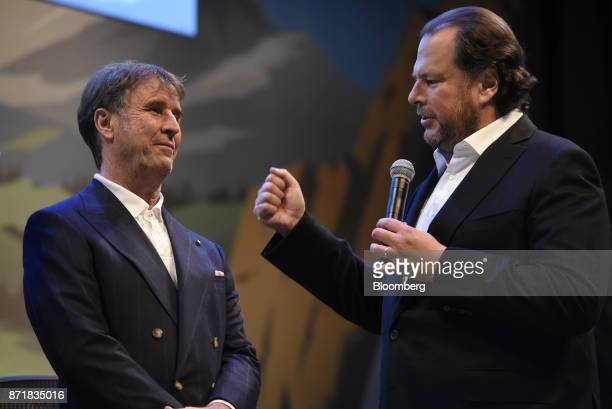 Marc Benioff chairman and chief executive officer of Salesforcecom Inc right speaks as Brunello Cucinelli chief executive officer of Brunello...