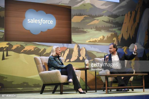 Marc Benioff chairman and chief executive officer of Salesforcecom Inc right speaks as Ginni Rometty chief executive officer of International...
