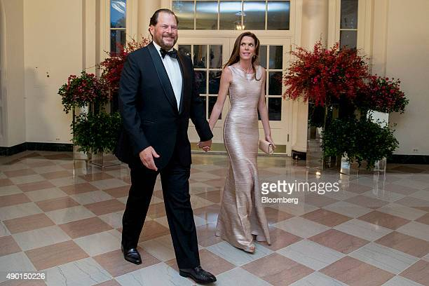 Marc Benioff chief executive officer of Salesforcecom Inc left and his wife Lynne Benioff arrive at a state dinner in honor of Chinese President Xi...