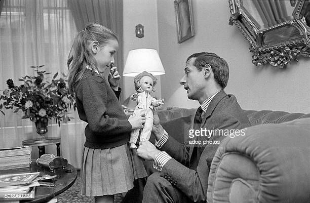 Marc Bohan French fashion designer at Dior with his daughter in Paris In 1961