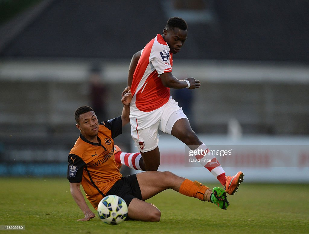 Marc Bola of Arsenal rides the challenge from Aaron Simpson of Wolves during the match between Arsenal U21s and Wolverhampton Wanderers U21s at Meadow Park on May 18, 2015 in Borehamwood, England.