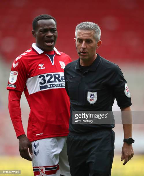 Marc Bola of Middlesborough talks to Match Referee Darren Bond during the Sky Bet Championship match between Middlesbrough and Reading at Riverside...
