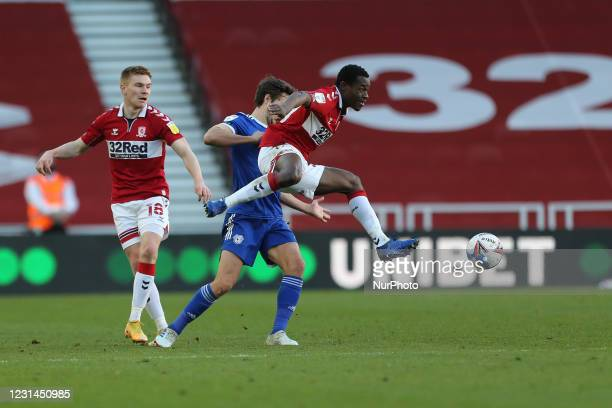 Marc Bola of Middlesbrough in action with Will Vaulks of Cardiff City whilst Duncan Watmore looks on during the Sky Bet Championship match between...