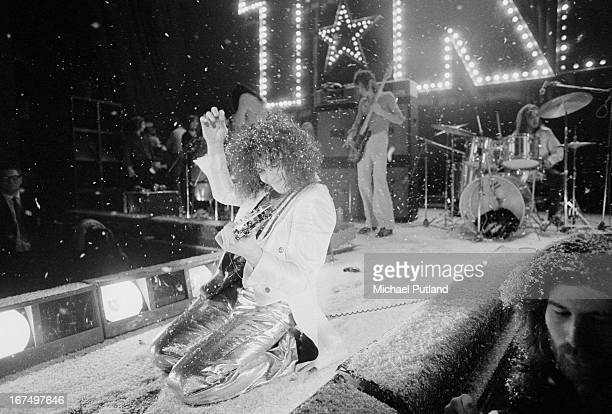 Marc Bolan performing with English glam rock group TRex at the Sundown Edmonton London 22nd December 1972 In the background are drummer Mickey Finn...