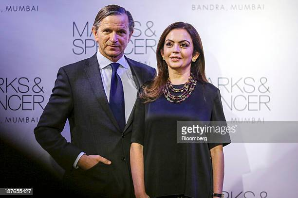 Marc Bolland chief executive officer of Marks Spencer Group Plc left stands with Nita Ambani the wife of Mukesh Ambani the Indian billionaire and...