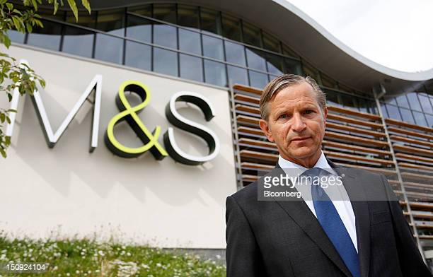 Marc Bolland chief executive officer of Marks Spencer Group Plc poses for a photograph outside the company's new Cheshire Oaks store in Chester UK on...