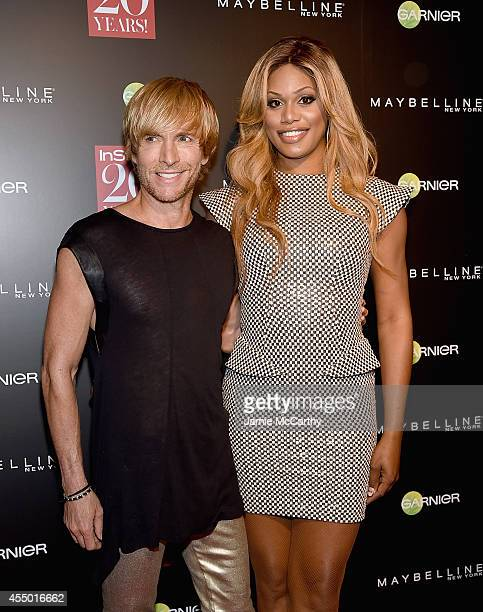 Marc Bouwer and Laverne Cox attend the Instyle 20th Anniversary Party at Diamond Horseshoe at the Paramount Hotel on September 8 2014 in New York City