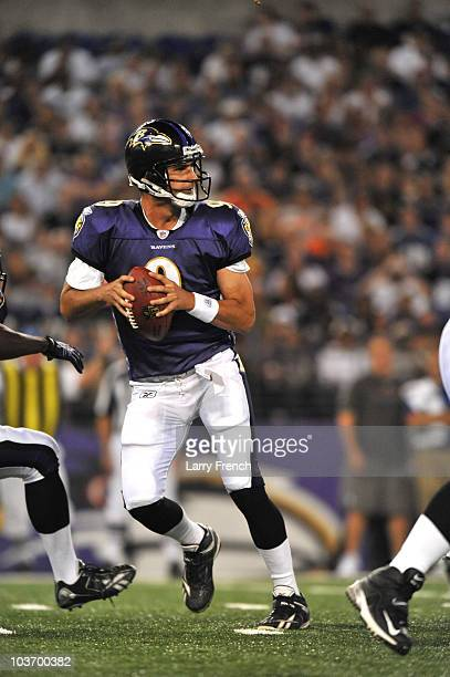 Marc Bulger of the Baltimore Ravens passes against the New York Giants in a preseason game at MT Bank Stadium on August 28 2010 in Baltimore Maryland...