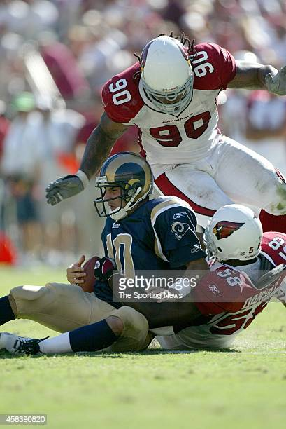 Marc Bulger of the St Louis Rams is sacked during a game against the Arizona Cardinals on September 18 2005 at the University of Phoenix Stadium in...