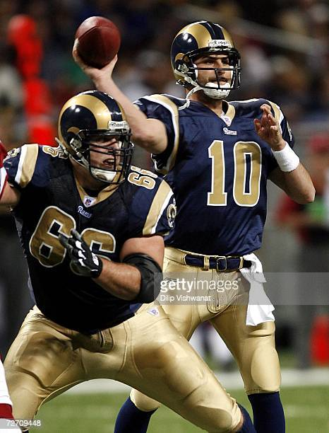 Marc Bulger of the St Louis Rams looks to pass against the Arizona Cardinals at the Edward Jones Dome on December 3 2006 in St Louis Missouri The...