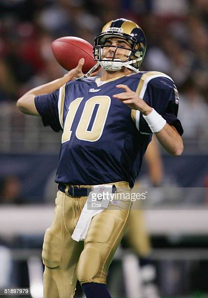 Marc Bulger of the St Louis Rams passes against the Seattle Seahawks during the game on November 14 2004 at the Edward Jones Dome in St Louis...