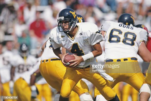 Marc Bulger Quarterback for the West Virginia University Mountaineers runs the ball during the NCAA Big East Conference college football game against...