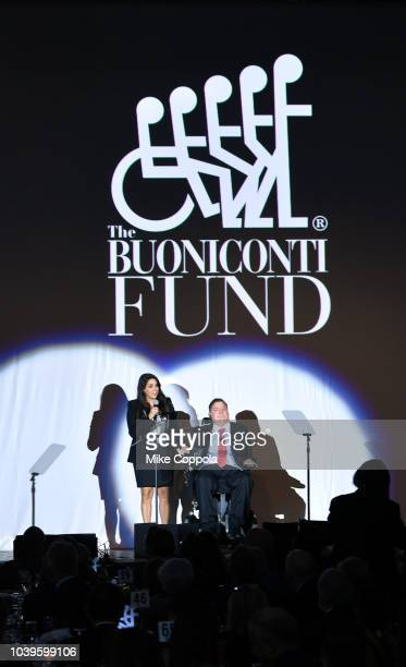 Marc Buoniconti and Stephanie Sayfie Aagaard speak on stage during the 33rd Annual Great Sports Legends Dinner which raised millions of dollars for...
