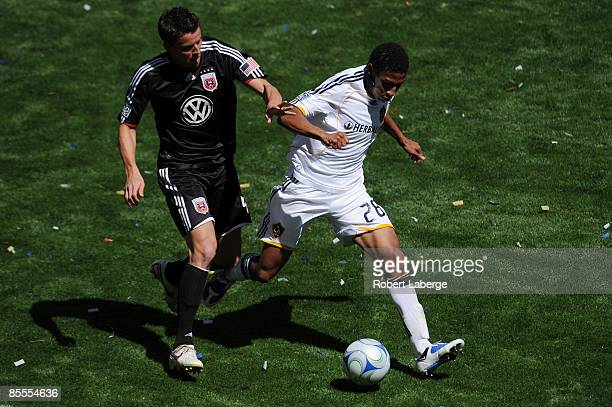 Marc Burch of DC United fights for the ball with Sean Franklin of the Los Angeles Galaxy at the Home Depot Center on March 22 2009 in Carson...