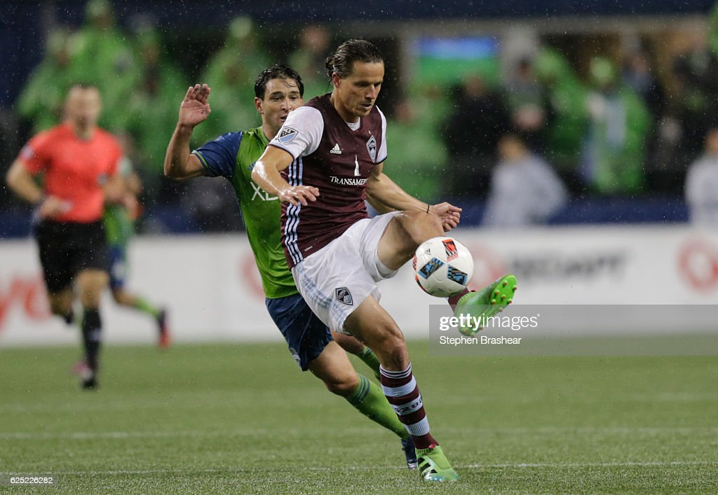 Marc Burch #4 of the Colorado Rapids passes the ball back as Nicolas Lodeiro #10 of the Seattle Sounders challenges during the second half of a match in the first leg of the Western Conference Finals at CenturyLink Field on November 22, 2016 in Seattle, Washington. The Sounder won the match 2-1.