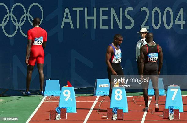 Marc Burns of Trinidad walks of the track after he was red carded for false start in the men's 100 metre event on August 21 2004 during the Athens...