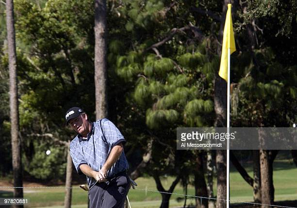 Marc Calcavecchia sinks a chip shot for a birdie on the 10th hole at the Chrysler Championship Friday October 31 2003 at Palm Harbor Florida