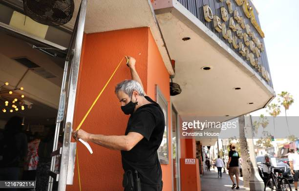 Marc Canter measures in case he needs to board up the doors and windows at Canter's Deli on Fairfax on Sunday May 31 2020
