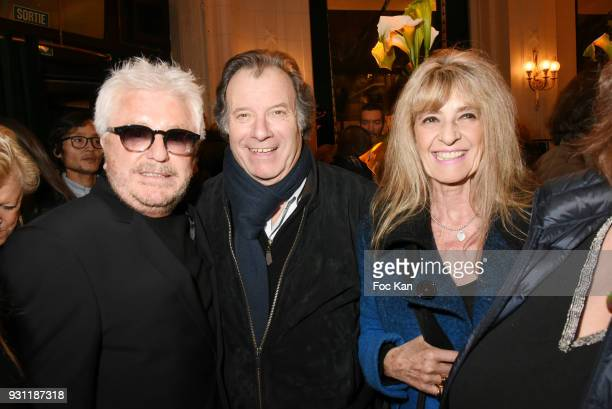 Marc Cerrone actor Daniel Russo and his wife Lucie Russo attend Marc Cerrone Exhibition Preview at Deux Magots on March 12 2018 in Paris France