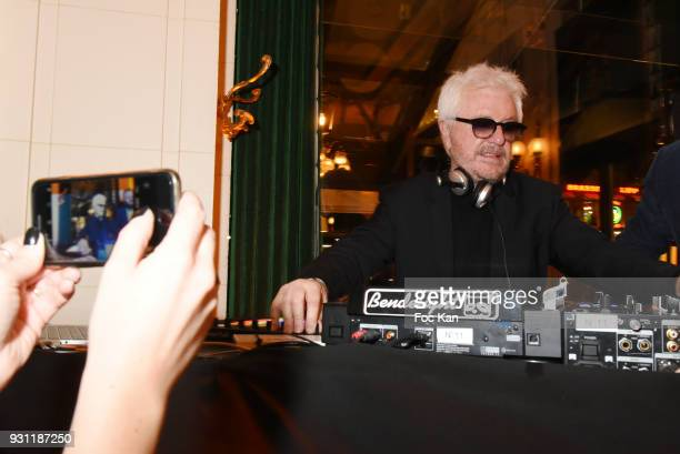 Marc Cerrone performs as DJ during Marc Cerrone Exhibition Preview at Deux Magots on March 12 2018 in Paris France