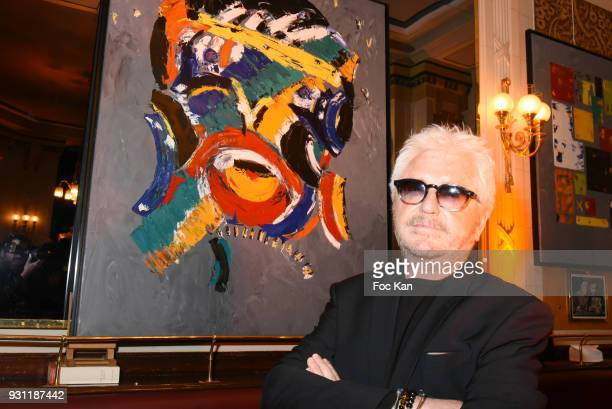 Marc Cerrone poses with his work during Marc Cerrone Exhibition Preview at Deux Magots on March 12 2018 in Paris France