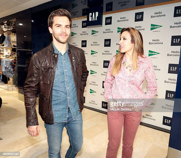 Marc Clotet and Gisela Llado 'Gisela' attend the GAP Space Inauguration at the Sfera in Placa Catalunya on March 11 2015 in Barcelona Spain