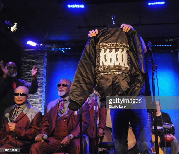 Marc Cohn receives an honorary Blind Boys of Alabama jacket from members Jimmy CarterClarence Fountain Paul Beasley Eric 'Ricky' McKinnie and Ben...