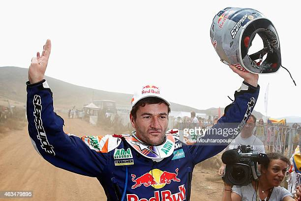 Marc Coma of Spain for the KTM Red Bull Rally Factory Team celebrates on the finish line after winnng the 2014 Dakar Rally on January 18 2014 in...