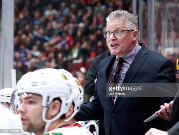 Marc Crawford looks on from the Chicago bench during their NHL game against the Vancouver Canucks at Rogers Arena January 2 2020 in Vancouver British...