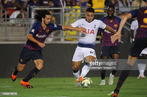 Marc Cucurella of FC Barcelona and Anthony Georgiou of Tottenham Hotspur battle for the ball during an International Champions Cup match at the Rose...