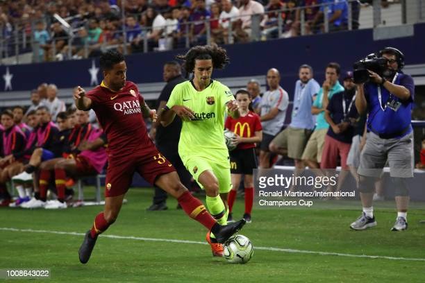 Marc Cucurella of FC Barcelona and Justin Kluivert of AS Roma vie for posession during their International Champions Cup 2018 match at ATT Stadium on...