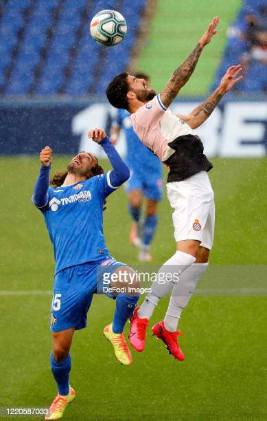 Marc Cucurella of FC Getafe and Marc Roca of Espanyol Barcelona battle for the ball during the Liga match between Getafe CF and RCD Espanyol at...