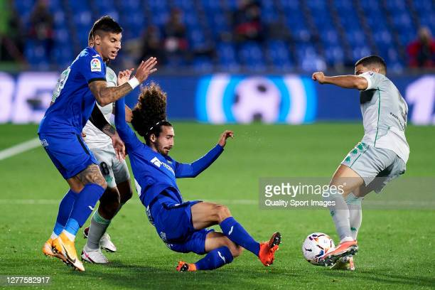 Marc Cucurella of Getafe CF battle for the ball with Nabil Fekir of Real Betis during the La Liga Santander match between Getafe CF and Real Betis at...