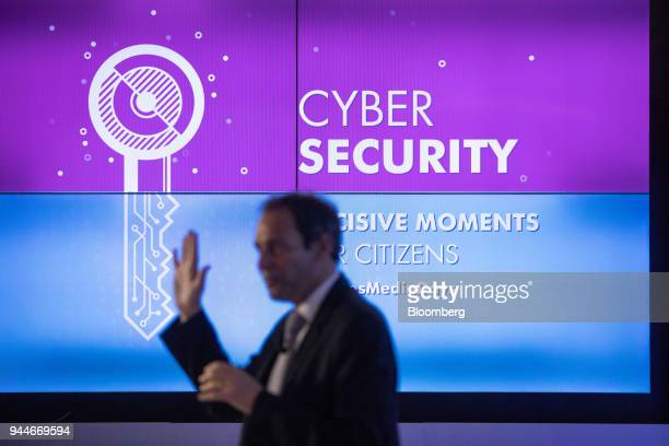 Marc Darmon vice president of secure communications and information systems at Thales SA gestures beside a digital key illustration during the Thales...