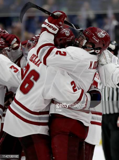 Marc Del Gaizo of the Massachusetts Minutemen is congratulated by Colin Felix after he scored the game winning goal in overtime against the Denver...