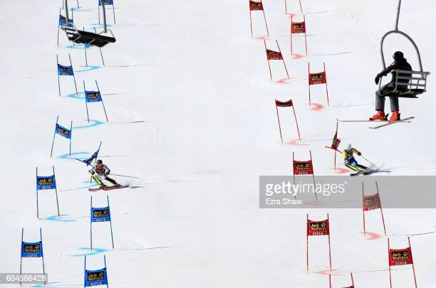 Marc Digruber of Austria races against Andre Myhrer of Sweden in the finals of the Alpine Team Event during the Audi FIS Ski World Cup Finals at...