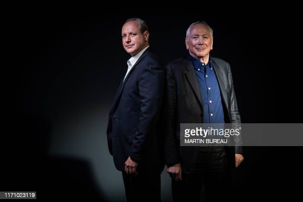 TOPSHOT Marc Dorcel productions director Gregory Dorcel and his father and founder aka Marc Dorcel pose during a photo session in Paris on September...