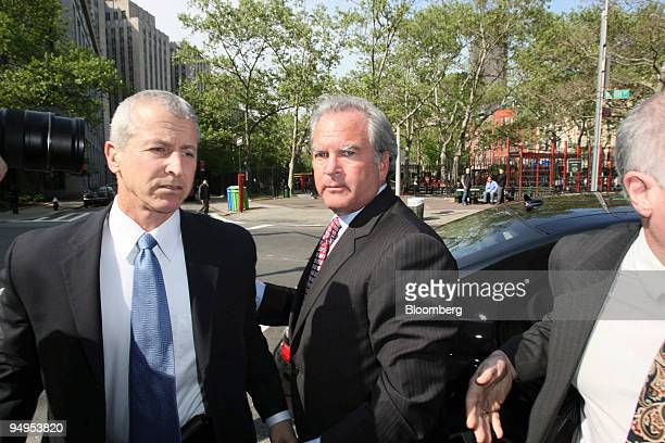Marc Dreier, founder of Dreier LLP, center, arrives at federal court for a hearing in New York, U.S., on Monday, May 11, 2009. Dreier is accused of...