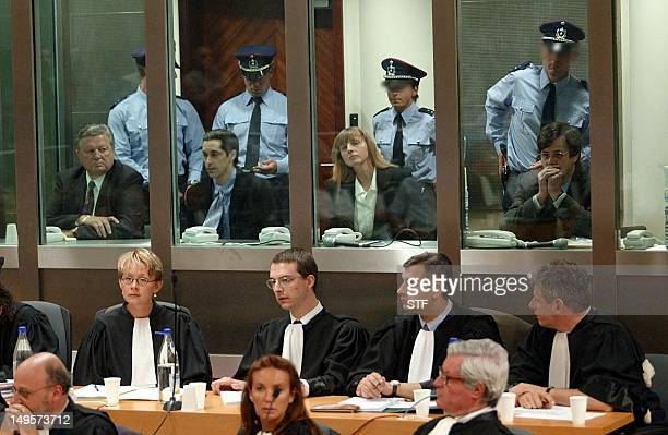 Marc Dutroux Michelle Martin Michel Lelievre and Michel Nihoul sit 17 June 2004 during the reading of the verdict at the Arlon courthouse Belgian...