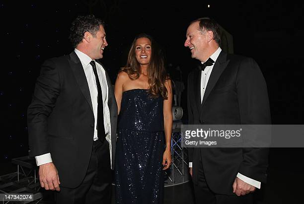 Marc Ellis and his wife Agustina talk with New Zealand Prime Minister John Key during the launch of the New Zealand Olympic Team uniform at the Prime...
