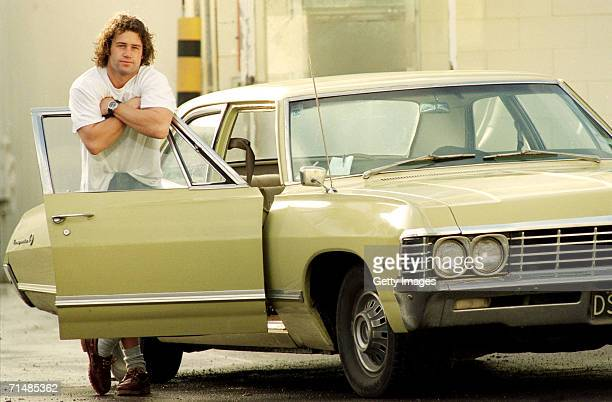 Marc Ellis of the New Zealand All Blacks poses with his Chevy Impala June 26 1996 in New Zealand Ellis is a former New Zealand rugby league and rugby...