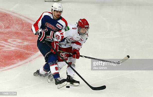 Marc ElSayed of Mannheim is challenged by Marcel Ohmann of Koeln during the DEL match between Adler Mannheim and Koelner Haie at SAP Arena on...