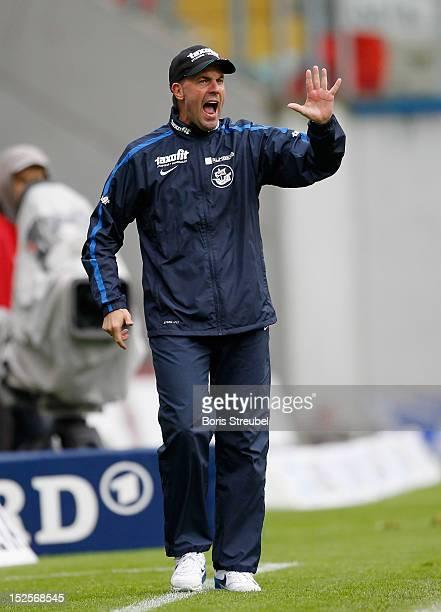 Marc Fascher head coach of Rostock gestures during the Third League match between Hansa Rostock and Hallescher FC at DKBArena on September 22 2012 in...