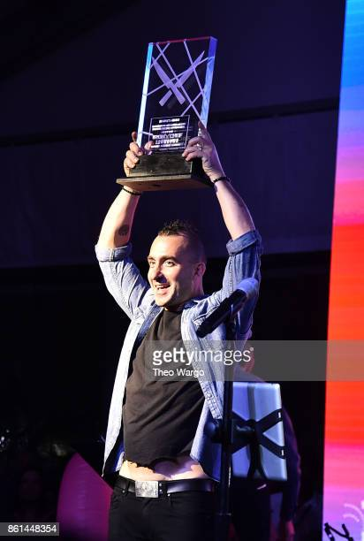 Marc Forgione holds the People's Choice trophy at the Food Network Cooking Channel New York City Wine Food Festival presented by CocaCola Rooftop...