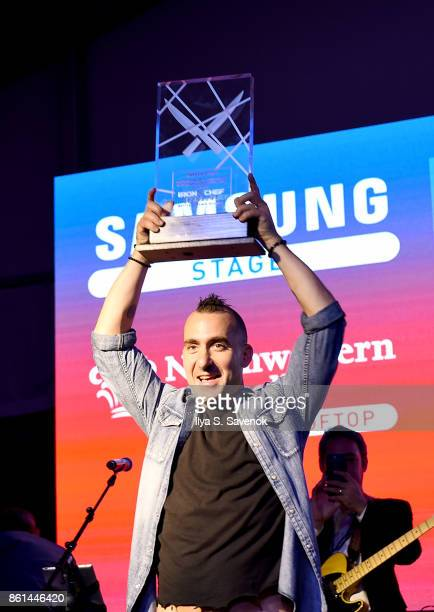 Marc Forgione holds the People's Choice winner's trophy at the Food Network Cooking Channel New York City Wine Food Festival presented by CocaCola...