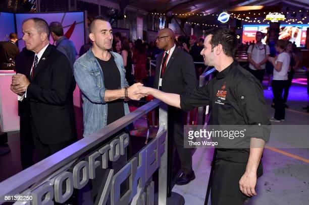 Marc Forgione meets a fan at the Food Network Cooking Channel New York City Wine Food Festival presented by CocaCola Rooftop Iron Chef Showdown...
