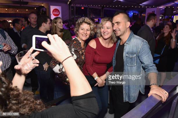 Marc Forgione poses with fans at the Food Network Cooking Channel New York City Wine Food Festival presented by CocaCola Rooftop Iron Chef Showdown...