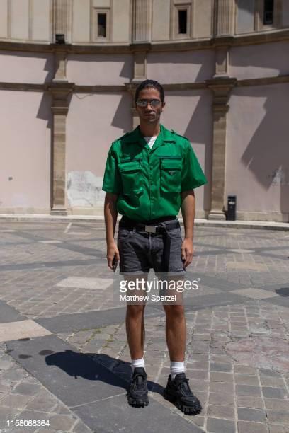 Marc Forne is seen on the street during men's Paris Fashion Week wearing rgeen Prada shirt, grey shorts and black sneakers on June 22, 2019 in Paris,...